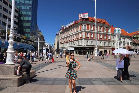 ZAGREB, CROATIA - JUNE 30, 2019: People visit Trg Bana Josipa Jelacica square in Zagreb, capital city of Croatia. Zagreb is the largest city of Croatia with 1.2 million people in its metro area. Editorial