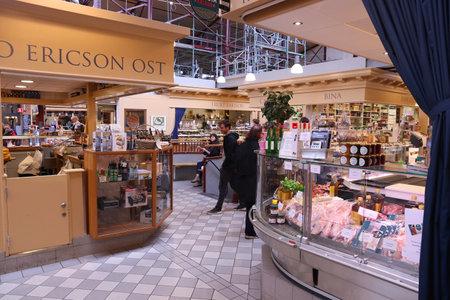 GOTHENBURG, SWEDEN - AUGUST 27, 2018: Old food and gourmet cuisine marketplace in Gothenburg, Sweden. The Stora Saluhallen market is located at Kungstorget square.