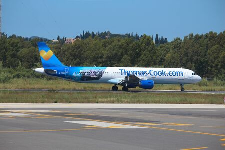 CORFU, GREECE - JUNE 6, 2016: Thomas Cook Airline Airbus A321 at Corfu International Airport, Greece. Thomas Cook Group is a British global travel company that went bankrupt in September 2019. Sajtókép