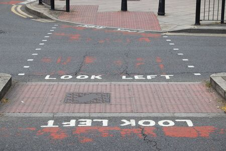 London pedestrian signs - look right and look left. Traffic warning.