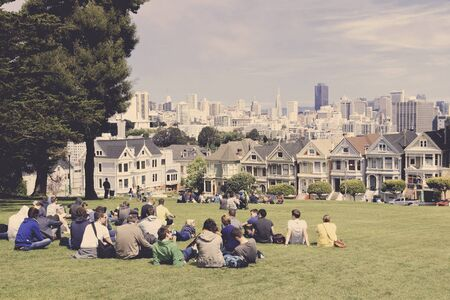 SAN FRANCISCO, USA - APRIL 9, 2014: People visit Alamo Square in San Francisco, USA. San Francisco is the 4th most populous city in California (837,442 people in 2013).