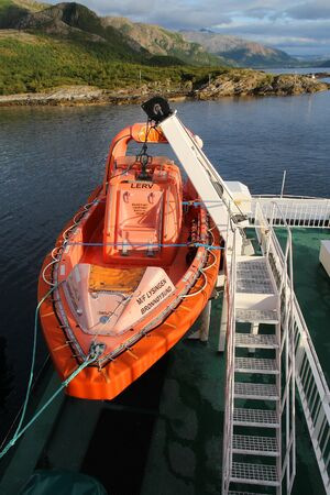 HOLM, NORWAY - JULY 22, 2015: Life boat on the ferry ship across Bindalfjord, Norway. Public transport by ferry in Norway carries more than 8 million passengers annually. 新聞圖片
