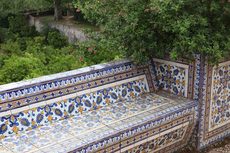 Tomar Convent of Christ - Knights Templar monastery in Portugal. Ornamental blue tiles (azulejos) on a garden bench. Stock Photo
