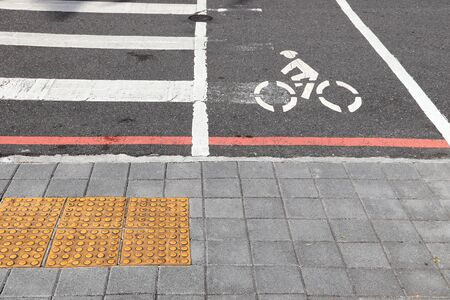 Bicycle lane in Taipei, Taiwan. Transportation infrastructure. Pedestrian crossing with visual impairment tactile paving.