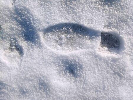 Snow shoe print. Winter in Poland. Shoe tracks.
