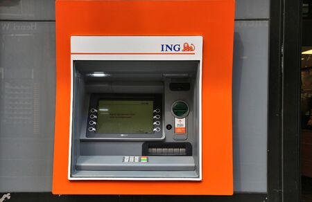 AMSTERDAM, NETHERLANDS - JULY 10, 2017: ING Bank ATM in Amsterdam, Netherlands. ING Group is one of largest banks in the world, with total assets of US$1.1 trillion.