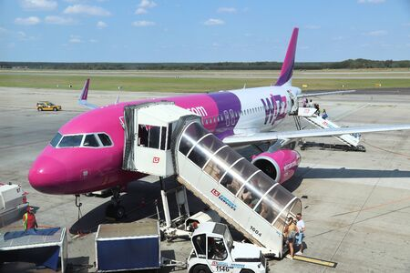 KATOWICE, POLAND - AUGUST 22, 2018: Passengers board low cost airline Wizz Air Airbus A320 aircraft at Katowice Airport in Poland. Katowice is the 4th busiest airport in Poland (4.8 m annual passengers).