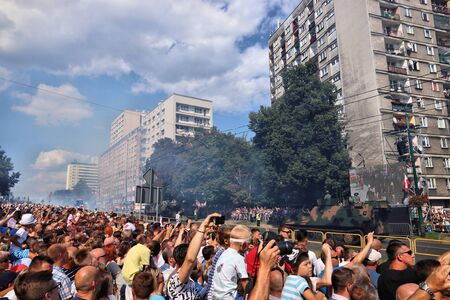 KATOWICE, POLAND - AUGUST 15, 2019: People visit the parade for Armed Forces Day in Katowice, Poland. Fumes pollution from tanks and armored transport vehicles. Publikacyjne