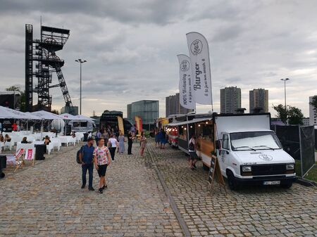 KATOWICE, POLAND - AUGUST 10, 2019: People visit food trucks at a music event Meskie Granie in Katowice, Poland.