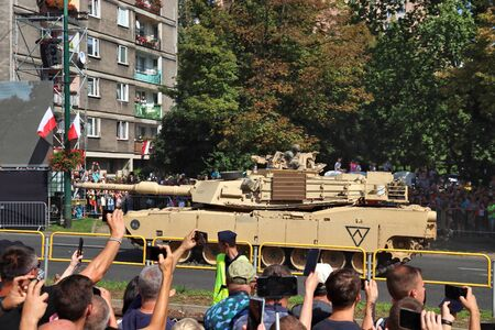KATOWICE, POLAND - AUGUST 15, 2019: People visit the parade for Armed Forces Day in Katowice, Poland. M1 Abrams tank performance. Publikacyjne