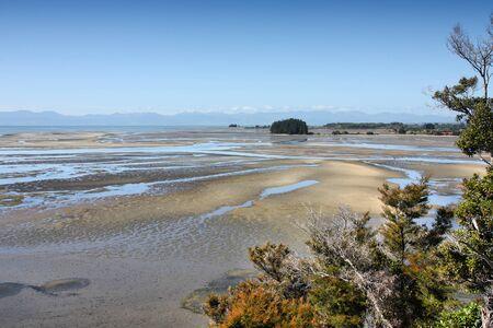 Tidal mudflats landscape. Wetlands at Tapu Bay, South Island, New Zealand.