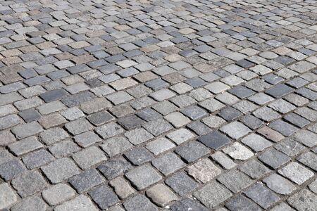 Stone paving background - granite cobblestone pattern in Nuremberg, Germany.