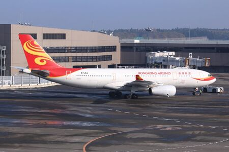 TOKYO, JAPAN - DECEMBER 5, 2016: Hongkong Airlines Airbus A330 taxies at Narita Airport of Tokyo. The airport is the 2nd busiest airport of Japan with 34,751,221 annual passengers (2015). 報道画像