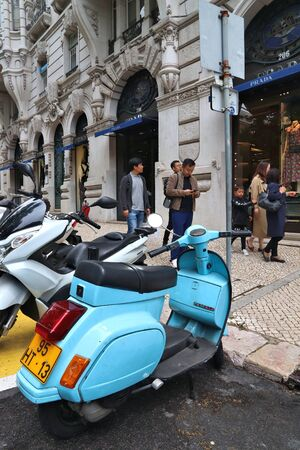 LISBON, PORTUGAL - JUNE 6, 2018: Shoppers visit Avenida da Liberdade (Liberty Avenue) in Lisbon, Portugal. This famous boulevard is renowned for luxury brand shopping and prime real estate.