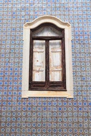 Faro, Portugal. Azulejos blue old Portuguese ceramic tiles decoration. Architecture in Portugal.