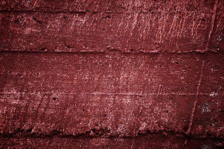 Cement background. Grunge concrete wall texture. Dark red claret color.