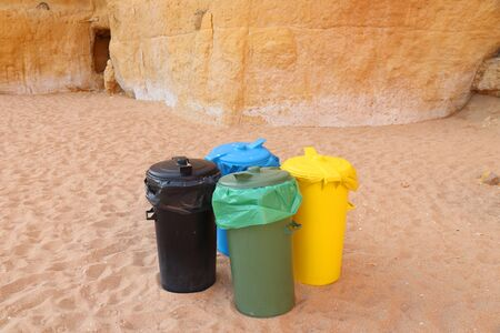 Clean beach. Waste sorting containers at a public beach in Algarve, Portugal. Recycling concept in Europe.