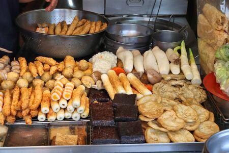 Taiwan night food market - Raohe Night Market in Taipei. Tofu, fish balls and other food - Chinese cuisine.