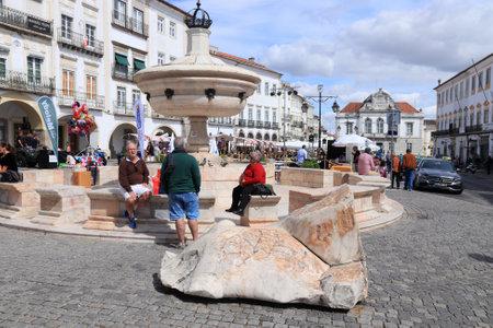 EVORA, PORTUGAL - JUNE 3, 2018: People visit Giraldo Square (Praca do Giraldo) in Evora, Portugal. Evora is a UNESCO World Heritage Site.