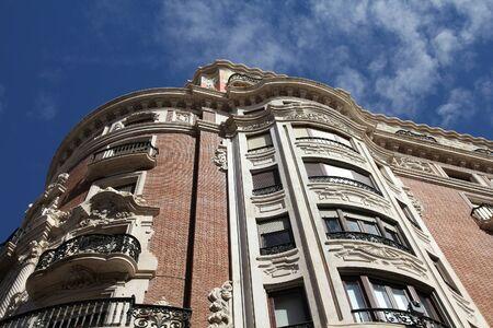 Valencia city, Spain. Beautiful old apartment buildings street, residential architecture. Foto de archivo