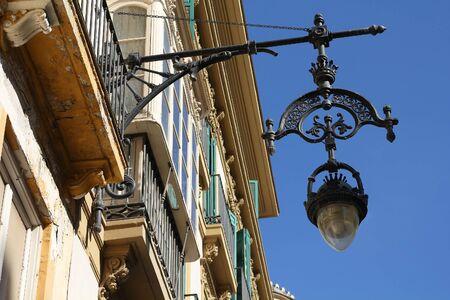 Malaga city, Spain. Old cast iron street lamp.