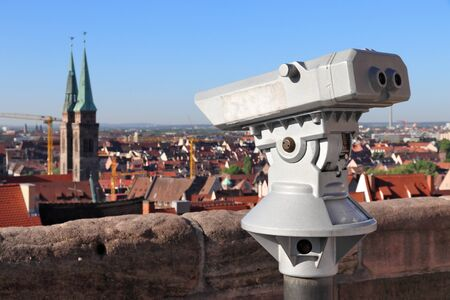 Nuremberg city, Germany. Old town viewpoint with binoculars. Tourist attraction.