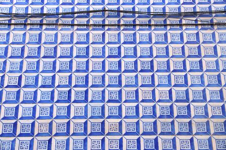 Azulejo tiles - traditional Portuguese tiles in Lisbon. Architecture ornament on building exterior. Stock Photo