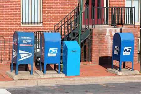 WASHINGTON, USA - JUNE 14, 2013: United States Postal Service mail boxes in Washington DC. USPS employs 626,764 people.