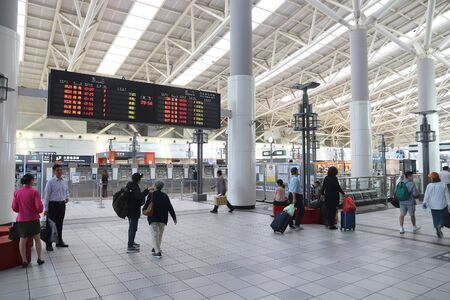 KAOHSIUNG, TAIWAN - NOVEMBER 30, 2018: Passengers visit Kaohsiung Main Station, Taiwan. Kaohsiung Station serves more than 14 million annual passengers.
