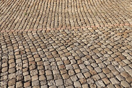 Stone paving background - granite cobblestone pattern in Chemnitz city, Germany.