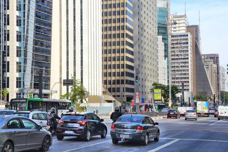 SAO PAULO, BRAZIL - OCTOBER 6, 2014: Cars drive at Avenida Paulista avenue, Sao Paulo. With 21.2 million people Sao Paulo metropolitan area is the 8th most populous in the world.
