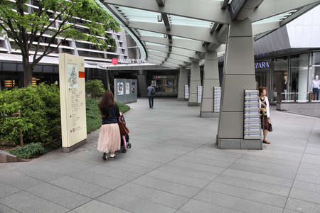 TOKYO, JAPAN - MAY 9, 2012: People visit Roppongi Hills in Tokyo, Japan. Roppongi Hills was completed in 2003 and is one of Japan's largest integrated property developments.
