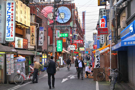OSAKA, JAPAN - APRIL 25, 2012: Evening street view in Namba district, Osaka, Japan. Osaka is Japan's 3rd largest city by population with 18 million people in its urban area.