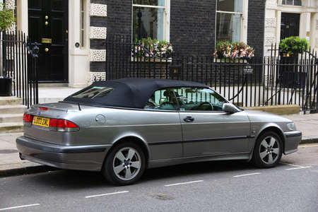 LONDON, UK - JULY 6, 2016: Silver Saab 93 convertible coupe car parked in London, UK. There are 2.6m cars registered in London.