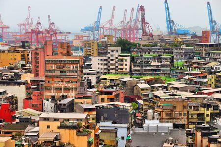 Keelung, Taiwan - urban cityscape with harbor cranes in background. Stock Photo