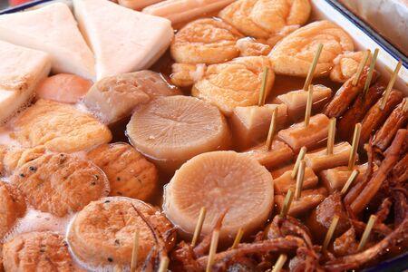 Japanese cuisine - oden food in soy broth. Typical winter food in Japan with dumplings, tofu and daikon. Tokyo street food. Reklamní fotografie