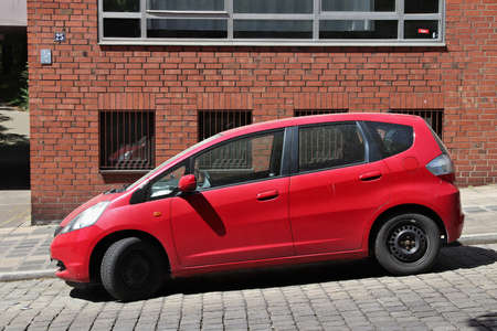 NUREMBERG, GERMANY - MAY 7, 2018: Red Honda Jazz compact car parked in Germany. There were 45.8 million cars registered in Germany (as of 2017). Editorial