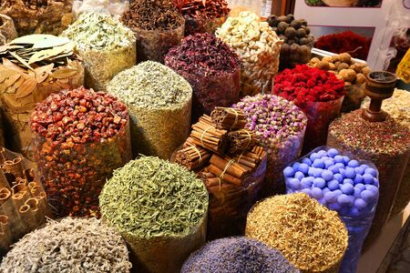 Dubai Spice Market (Dubai Spice Souk) - choice of colorful herbs and spices. Tourist attraction.
