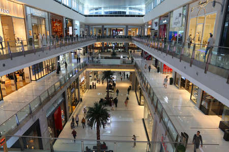 DUBAI, UAE - NOVEMBER 22, 2017: Shoppers visit Dubai Mall. It is the largest mall in the world by total area with 502,000 square metres retail area.