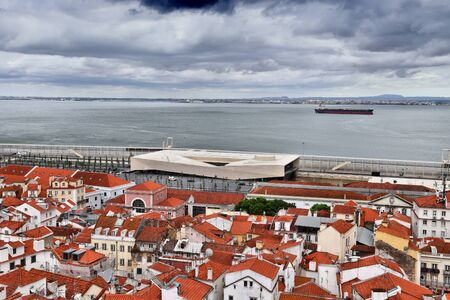 Lisbon city view rainy day. Alfama district architecture and Tagus river in Lisbon, Portugal.