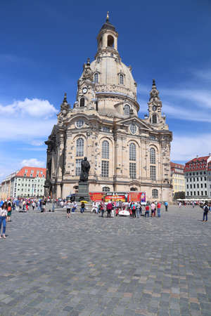 DRESDEN, GERMANY - MAY 10, 2018: Tourists visit Neumarkt square in Altstadt (Old Town) district of Dresden, the 12th biggest city in Germany.
