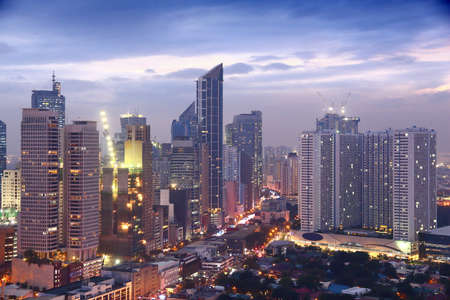 Makati city night skyline in Manila, Philippines. Office buildings.