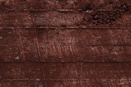Dark cement background. Grunge concrete wall texture. Dark brown color.