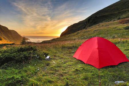 Red tent in Norway. Camping in Hoddevik Stadlandet peninsula of Nordjord district. Stock Photo