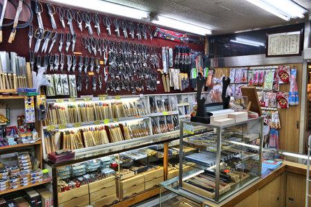 KYOTO, JAPAN - NOVEMBER 27, 2016: Specialist artisanal scissors store in Kyoto, Japan. Retail sales amounted to137.6 trillion yen in Japan in 2012.