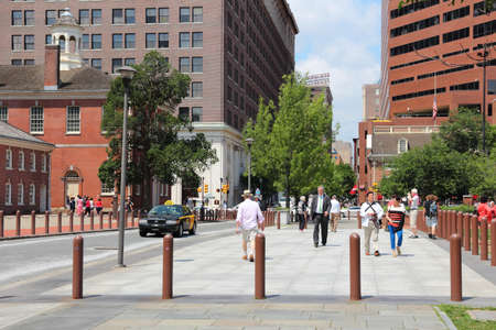 PHILADELPHIA, USA - JUNE 11, 2013: People walk in Philadelphia Historic District. As of 2012 Philadelphia is the 5th most populous city in the US with 1,547,607 citizens.