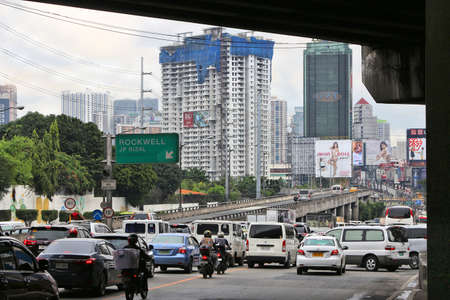 MANILA, PHILIPPINES - DECEMBER 8, 2017: Typical traffic congestion in Metro Manila, Philippines. Metro Manila is one of the biggest urban areas in the world with 24 million people.