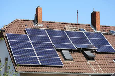 Solar panels on generic house roof. Photovoltaic energy generation near Dortmund, Germany.