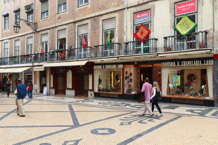 LISBON, PORTUGAL - JUNE 4, 2018: People visit Rua Augusta shopping street in Lisbon. Lisbon is the 11th-most populous urban area in the EU (2.8 million people).