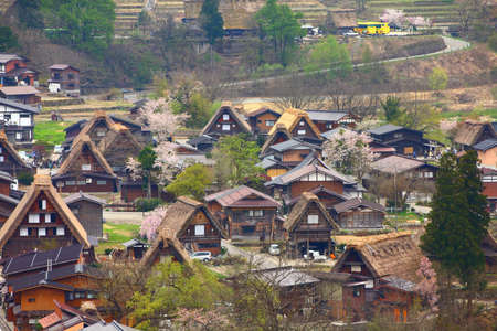 Shirakawa-go village aerial view, Japan. Landmark village with wooden homes and thatched roofs listed as UNESCO site.